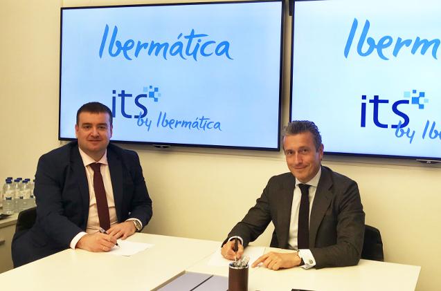 Los directivos de ITS e Ibermática sellan el acuerdo de adquisición.