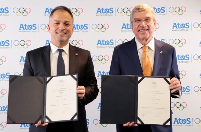 El CEO de Atos, Elie Girard, y el Presidente del COI, Thomas Bach